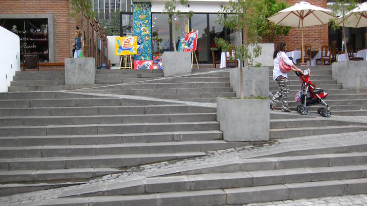 A non-handicap-friendly ramp cuts through a set of stairs